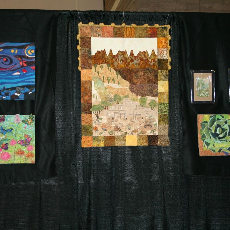 SAQA Booth, SAQA-AZ member artwork at the Tucson Quilt Fiesta, 2020, Tucson Convention Center, Tucson, AZ