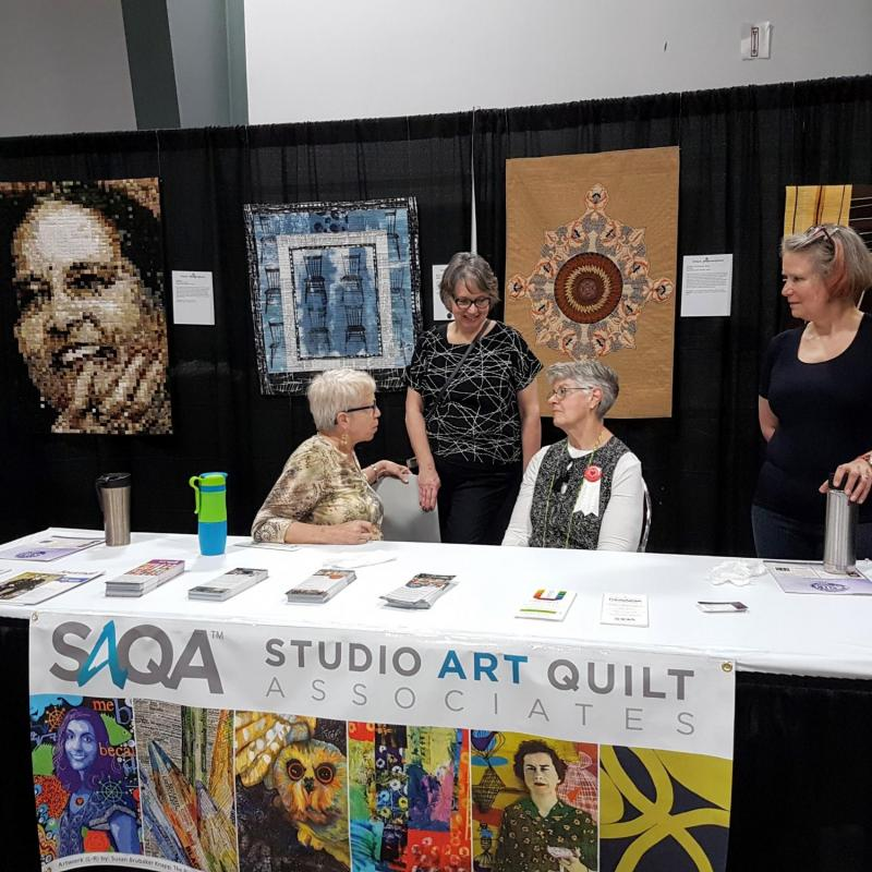 SAQA booth at Quilt Canada in Ottawa in June 2019. Photo by June Robertson
