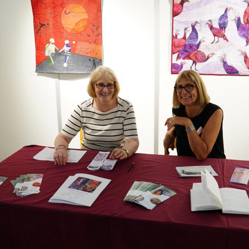 Volunteers at the SAQA booth at European Patchwork Meeting (France)
